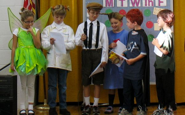 Sharing our clues on stage for the whole third grade